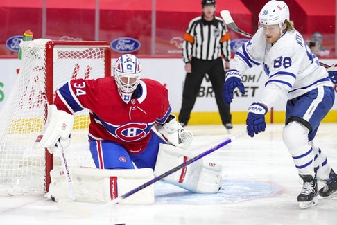 Canadiens goalie Jake Allen tracks the puck as it's chased by Toronto Maple Leafs forward William Nylander during a game this season at the Bell Centre.