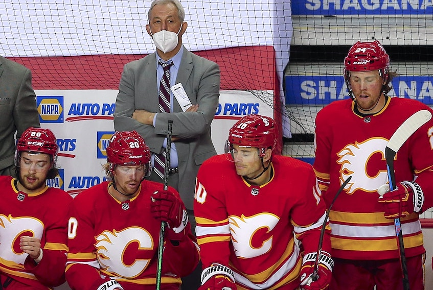 Calgary Flames coach Darryl Sutter looks on in the dying minutes of a 4-0 loss to the Winnipeg Jets at the Scotiabank Saddledome on May 5, 2021.