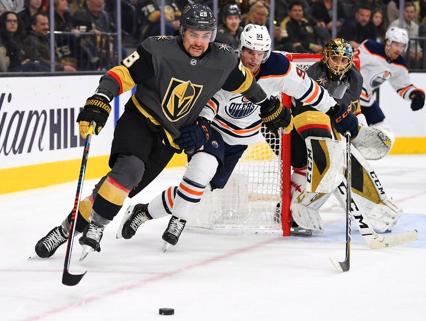 Vegas Golden Knights left winger William Carrier (28) skates the puck away from Edmonton Oilers center Gaetan Haas (91) as goaltender Marc-Andre Fleury looks on during the 2019-20 NHL regular season action in Vegas. Carrier and Fleury, both former Cape Breton Screaming Eagles, will be among seven Cape Breton connections playing in this year's NHL playoffs. POSTMEDIA PHOTO - Contributed