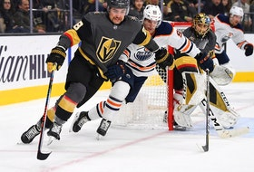 Vegas Golden Knights left winger William Carrier (28) skates the puck away from Edmonton Oilers center Gaetan Haas (91) as goaltender Marc-Andre Fleury looks on during the 2019-20 NHL regular season action in Vegas. Carrier and Fleury, both former Cape Breton Screaming Eagles, will be among seven Cape Breton connections playing in this year's NHL playoffs. POSTMEDIA PHOTO