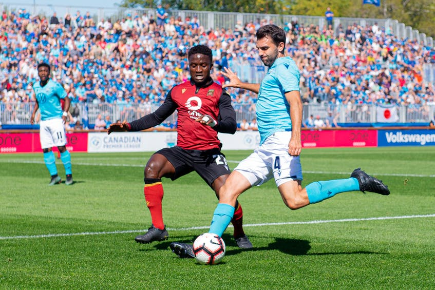 HFX Wanderers defender Alex De Carolis fends off a Valour FC attacker during a Canadian Premier League game in 2019 at the Wanderers Grounds. - HFX Wanderers