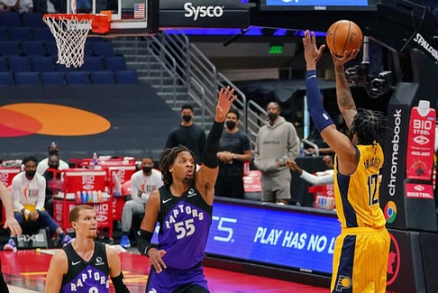 Indiana Pacers forward Oshae Brissett, right, attempts a three point shot over Toronto Raptors forward Freddie Gillespie during the first half at Amalie Arena in Tampa, Fla., May 16, 2021.