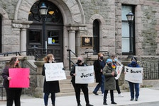 "About two-dozen folks gathered outside the Supreme Court of Newfoundland and Labrador building on Duckworth Street in downtown St. John's on Saturday morning in rally of the ""supportforJaneDoe"" movement to support the victim of a 2014 sexual assault by RNC officer Const. Doug Snelgrove. They gathered there as the jury deliberated Snelgrove's fate at the temporory Supreme Court of Newfoundland in the former School for The Deaf on Topsail Road on Saturday afternoon morning. After a verdict was reached mid-Saturdsay afternoon, Snelgrove, 43, was found guilty of sexually assaulting a then 20-year-old woman. The officer drove her home in an RNC vehicle in December 2014 and allegedly sexually assauklted here prior to the verdict. After three days of deliberations, the 12-member jury reached their verdict. He is scheduled to appear back in Supreme Court on June 7th. for a sentencing hearing. -Joe Gibbons/The Telegram"