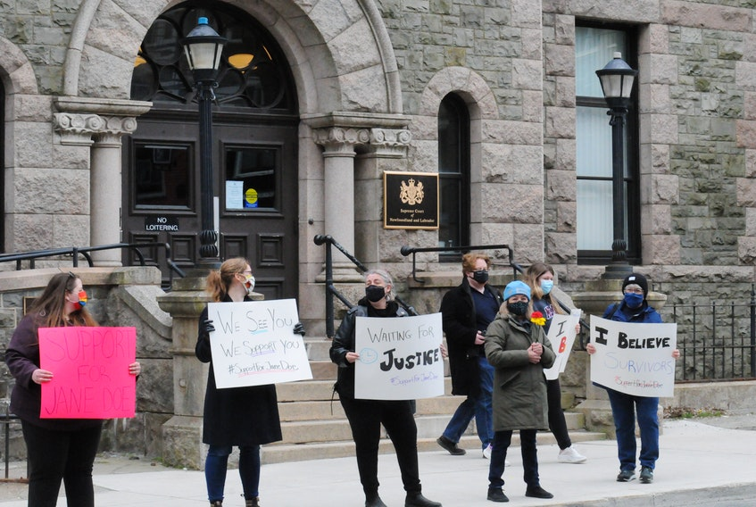 """About two-dozen folks gathered outside the Supreme Court of Newfoundland and Labrador building on Duckworth Street in downtown St. John's on Saturday morning in rally of the """"supportforJaneDoe"""" movement to support the victim of a 2014 sexual assault by RNC officer Const. Doug Snelgrove. They gathered there as the jury deliberated Snelgrove's fate at the temporory Supreme Court of Newfoundland in the former School for The Deaf on Topsail Road on Saturday afternoon morning. After a verdict was reached mid-Saturdsay afternoon, Snelgrove, 43, was found guilty of sexually assaulting a then 20-year-old woman. The officer drove her home in an RNC vehicle in December 2014 and allegedly sexually assauklted here prior to the verdict. After three days of deliberations, the 12-member jury reached their verdict. He is scheduled to appear back in Supreme Court on June 7th. for a sentencing hearing. -Joe Gibbons/The Telegram"""