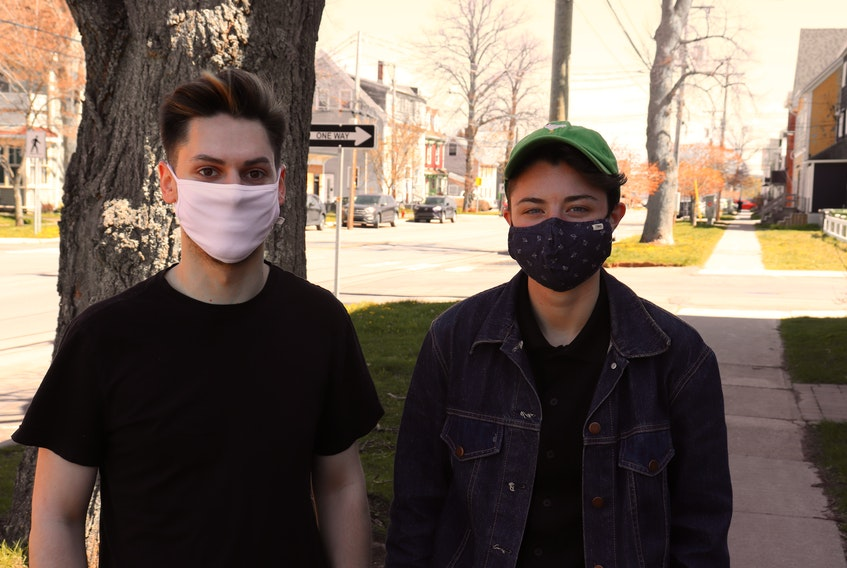 Tyler Murnaghan, left, and Hal Atwood led the local organizing of the International Day Against Homophobia, Transphobia and Biphobia, which is today.