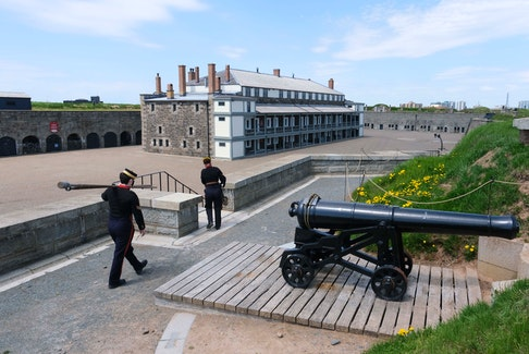 FOR STU PEDDLE STORY: Reenactors of the 3rd Brigade Royal Artillery file away after firing the noon gun at Halifax Citadel National Historic Site  Sunday May 16, 2021. Parks Canada has announced a delay in opening their parks this year due to COVID19...SEE STORY FOR MORE DETAILS   Tim Krochak pic
