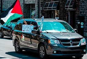 Protesters held signs and the Palestinian flag during the #FreePalestine rally that was held in Halifax on Saturday. Photo Credit: Mohammed Al-Karmanji