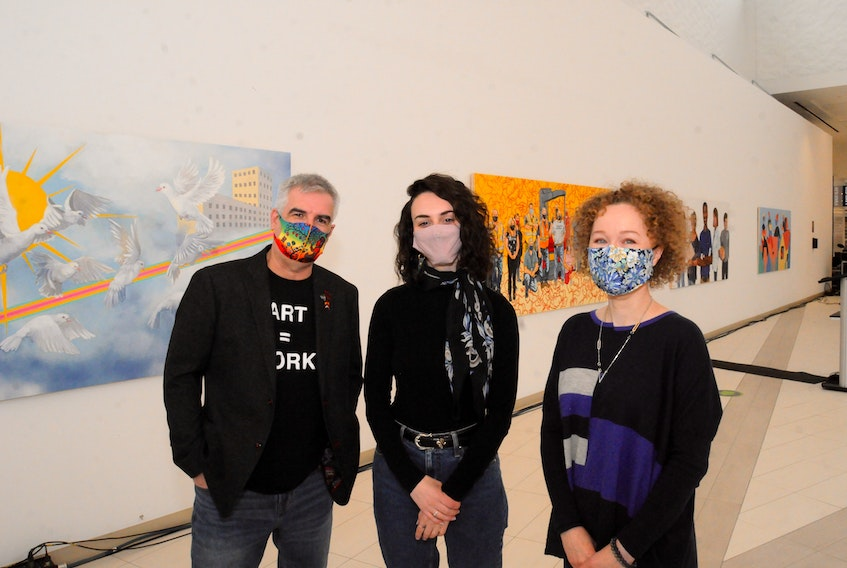 With their work behind them, pictured are artists. Pictured are artists Nelson White, Molly Margaret and Anastasia Tiller. Missing from photo is Amber-Lynn Thorne, who was unable to attend the event.