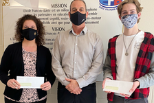 Danny Miller, centre, director of occupational health and safety at WCB P.E.I., presents this year's winner of the P.E.I. High School Video Contest, Etienne Foulkes, right, and the principal of École François Buote, Isabelle Savoie-Jamieson, left, with their prize.