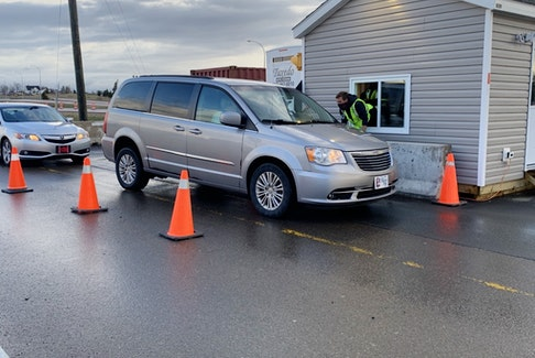 A border liaison officer speaks to a motorist coming into Nova Scotia at the border checkpoint at Fort Lawrence in April when Nova Scotia Premier Iain Rankin announced tighter restrictions on vehicles entering the province. Even tighter restrictions went into place May 10 and remain in effect.