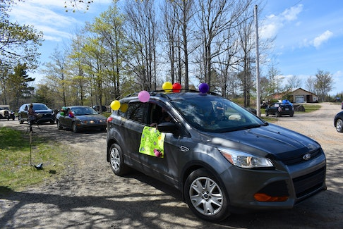 Parade participants shouted birthday greetings from their vehicles as they passed by the guest of honour's home. – Ashley Thompson