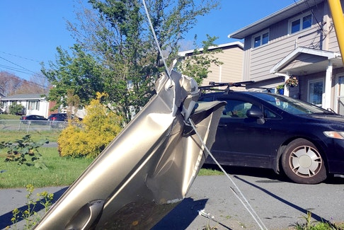 A car door is seen after somebody left the road and smashed into another vehicle in a Lower Sackville driveway on Saturday. - Contributed