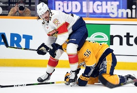Florida Panthers defenceman MacKenzie Weegar (52) watches the puck after Nashville Predators winger Erik Haula (56) loses control during an April 27 game at Bridgestone Arena in Nashville. - Christopher Hanewinckel-USA TODAY Sports