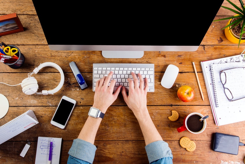 Another busy day working or studying at home. STOCK IMAGE