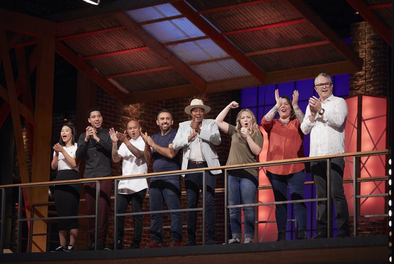 Past competitors from MasterChef Canada: Back to Win, including fourth-place Halifax chef Andrew Al-Khouri (fourth from left), cheer on the final three chefs as they complete their challenges for the top spot in the kitchen. - CTV/Bell Media