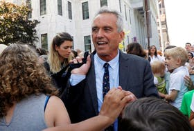 Attorney Robert F. Kennedy Jr. is surrounded by supporters as he departs New York State Supreme Court after a hearing challenging the constitutionality of the NY State Legislature's repeal of the religious exemption to vaccination in Albany, New York, U.S., August 14, 2019.