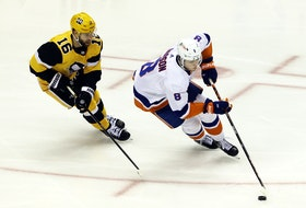 New York Islanders defenceman Noah Dobson, a Summerside native, moves the puck ahead of Pittsburgh Penguins left-winger Jason Zucker in overtime of Game 1 of their playoffs series.