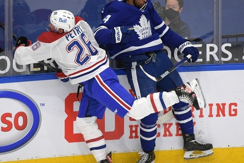 Montreal Canadiens defenceman Jeff Petry (left) collides with Toronto Maple Leafs forward Wayne Simmonds during the regular season. The Leafs and Canadiens are meeting in the opening round of the NHL playoffs.