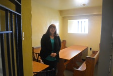 Brenda O'Reilly stands in one of the renovated jail cells in the old courthouse in Harbour Grace. O'Reilly and her business partner Craig Flynn bought the historic building in 2019 and have been converting it into a speakeasy and events space.
