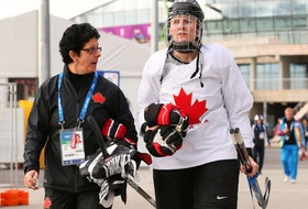 Danielle Goyette (left) and Hayley Wickenheiser walk through the Olympic Park in Sochi, Russia in a 2014 photo. Goyette is joining Wickenheiser on the staff of the Toronto Maple Leafs.