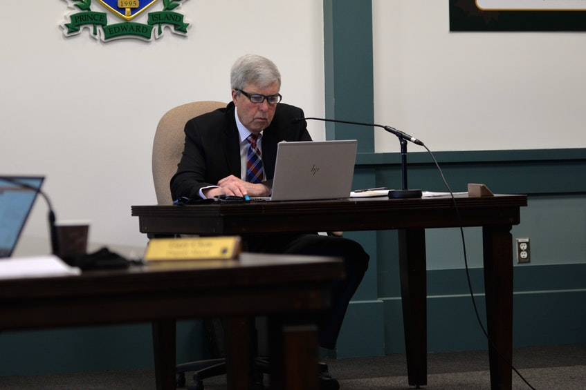 Stratford mayor Steve Ogden checks his computer during a May 12 town council meeting. - Terrence McEachern