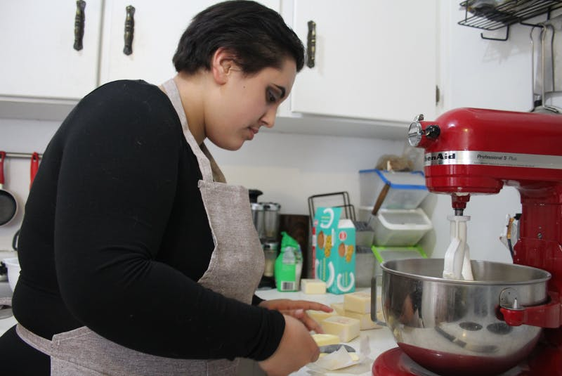 Charisa Lykow in her kitchen, working on on a buttercream frosting. - Kristin Gardiner