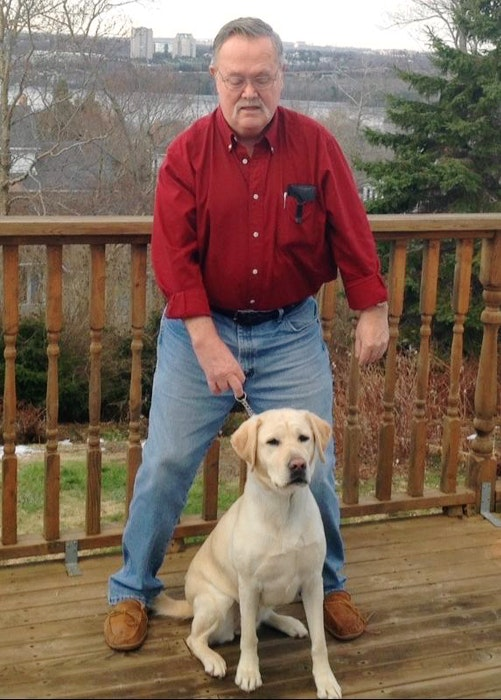 Kenneth Moore and his service dog Mattie. The specially trained Labrador retriever alerts the deaf Cheticamp resident to common sounds such as the telephone and doorbell and even recognizes when someone speaks to him and nudges him before leading him in the direction of the voice. CONTRIBUTED - Christopher Connors