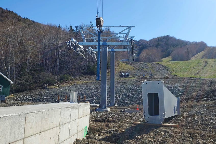 Construction of Atlantic Canada's first gondola lift continues at Ski Cape Smokey in Ingonish. The new transportation system, which will carry passengers to the top in eight-person cars, is part of a $130-million plan to redevelop the hill into an all-season resort. CONTRIBUTED