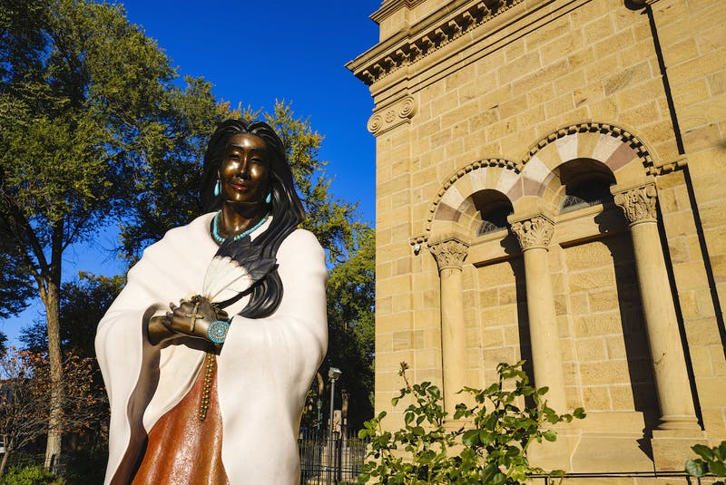 This statue of Kateri Tekakwitha stands outside the Cathedral Basilica of St. Francis of Assisi in Santa Fe, N.M. - 123RF Stock Photo