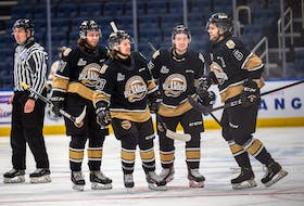 Charlottetown Islanders defenceman Noah Laaouan, right, celebrates his goal with teammates, from second right, Keiran Gallant, Zac Beauregard and Lukas Cormier in Game 1 of the Quebec Major Junior Hockey League semifinal in Quebec City. – Jonathan Roy