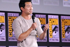 Canadian actor Simu Liu speaks on stage for the Marvel panel in Hall H of the Convention Center during Comic Con in San Diego, California on July 20, 2019.