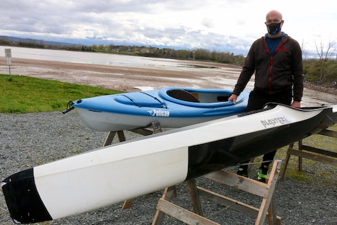 Sheldon Hope, the vice-commodore of the Pisiquid Canoe Club, provides a comparison between a recreational kayak, pictured on the left, and a sprint kayak, the type of light-weight vessel used by club athletes.