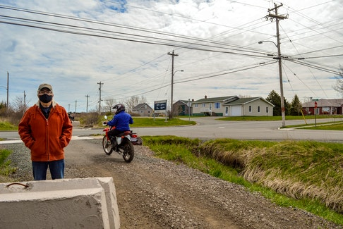 Ron Mazzocca moves out of the way for a couple of dirt bikers on the Coal Town Trail in Dominion. JESSICA SMITH • CAPE BRETON POST