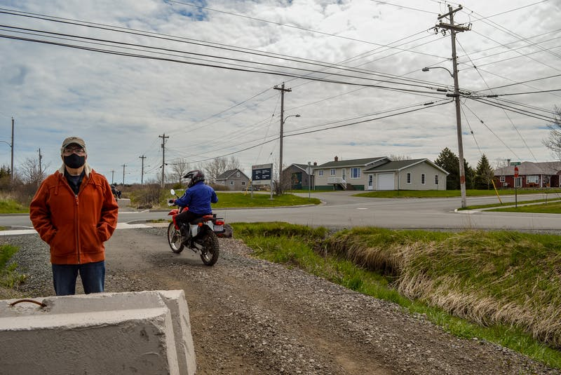 Ron Mazzocca moves out of the way for a couple of dirt bikers on the Coal Town Trail in Dominion. JESSICA SMITH • CAPE BRETON POST - Jessica Smith