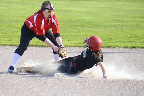 Torrie Coughlin of the Morell Marlins steals second by sliding safely under the tag of Charlottetown Rural Raiders shortstop Kate Doyle Monday during Prince Edward Island School Athletic Association senior AAA softball action at Central Field. The Raiders won the game 14-0 to improve to 3-0 while Morell is 0-2 after losing its opening game of the season 12-11 to Montague on May 10. Elsewhere on Monday, Bluefield defeated Kinkora 13-2, Colonel Gray beat Montague 13-1 and Three Oaks got by Westisle 11-4.