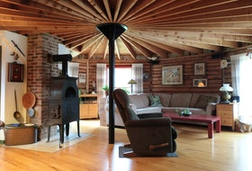 The interior of this 10-sided log house in Kings County was built with unstamped lumber.