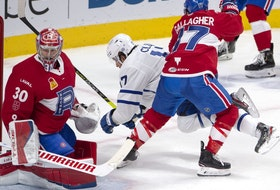 Laval Rocket's Brendan Gallagher (17) checks Toronto Marlies' Richard Clune in front of Marlies goaltender Carey Price during second period American Hockey League action in Montreal, Monday, May 17, 2021. Carey Price and Brendan Gallagher are on a one game conditioning loan to the Rocket before the start of their playoff series against the Toronto Maple Leafs.
