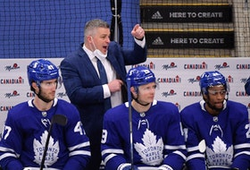 Toronto Maple Leafs head coach Sheldon Keefe speaks to his players as forward Pierre Engvall (47) and forward Jason Spezza (19) and forward Wayne Simmonds (24) listen during the third period against the Montreal Canadiens at Scotiabank Arena May 8, 2021.
