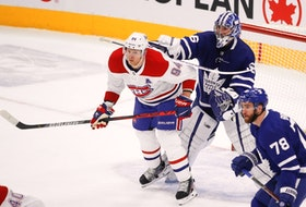 Maple Leafs goalie Jack Campbell gives Canadiens forward Corey Perry a shove during a game on May 6. The Toronto-Montreal series gets underway on Thursday.