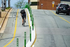 A cyclist pedals his way up the bike lane on Gottingen Street in Halifax on Tuesday. Ryan Taplin - The Chronicle Herald