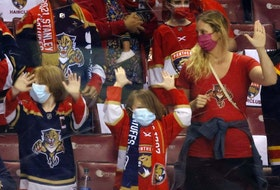 Florida Panthers fans greet the team during warmups prior to playing against the Tampa Bay Lightning in Game One of the First Round of the 2021 Stanley Cup Playoffs at the BB&T Center on May 16, 2021 in Sunrise, Fla.