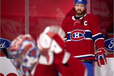 Canadiens captain Shea Weber looks on as goalie Carey Price makes a save during pregame warmup before a game at the Bell Centre against the Vancouver Canucks this season.