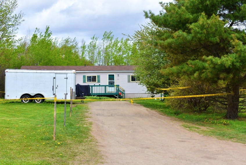 There was a home invasion at this trailer on Ridge Road in Melanson on the morning of May 24, 2020, and the suspects were seen leaving the area in a grey van. A few hours later, Robert Campbell's remains were found in a burned-out grey van in St. Croix. RCMP announced Wednesday that four people face charges in the homicide.