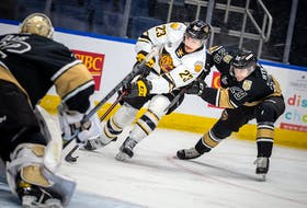Victoriaville Tigres forward Shawn Element, centre, breaks to the net while being defended by Charlottetown Islanders defenceman Sean Stewart Wednesday in Game 2 of the Quebec Major Junior Hockey League semifinal in Quebec City. - Jonathan Roy