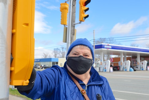 Louise Gillis, who is the national president of the Canadian Council of the Blind, prepares to cross a busy intersection in Sydney on her way to the grocery store. A former nurse, Gillis was left blind after suffering a sudden blood clot in her retinal vein in 1997. Chris Connors • Cape Breton Post