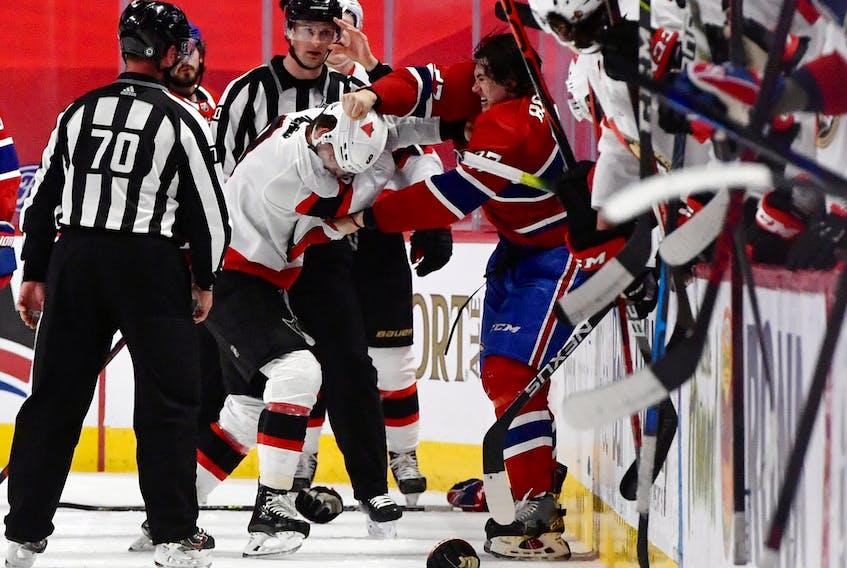 Ottawa Senators forward Josh Norris (9) fights with Montreal Canadiens defenceman Alexander Romanov  during Saturday's game.