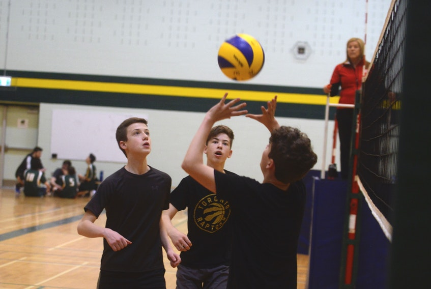 Members of the Charlottetown Capitals wait as teammate sets the ball recently during Volleyball P.E.I. 14-and-under boys spring league action recently at Birchwood Intermediate School in Charlottetown.