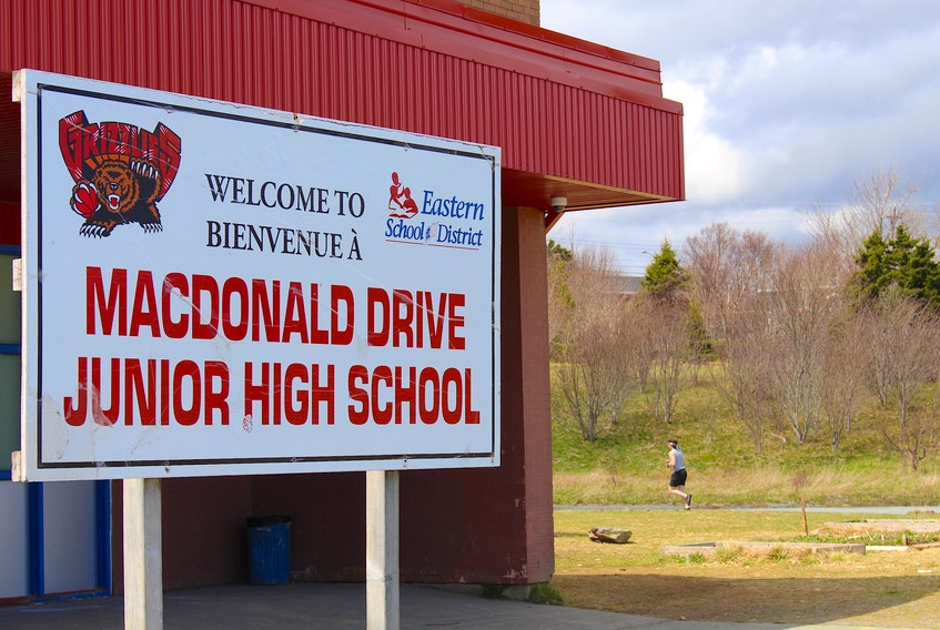 """Macdonald Drive Junior High School is one of four schools out of 93 on the Avalon scheduled to be on a """"compressed"""" school day as of today. Students will not be allowed to leave school grounds for the entire day, their lunch break is shortened to 20 minutes and their recess to five minutes. As well, they will get out of school an hour earlier than what was called for in the previous schedule.. — Andrew Waterman/The Telegram"""