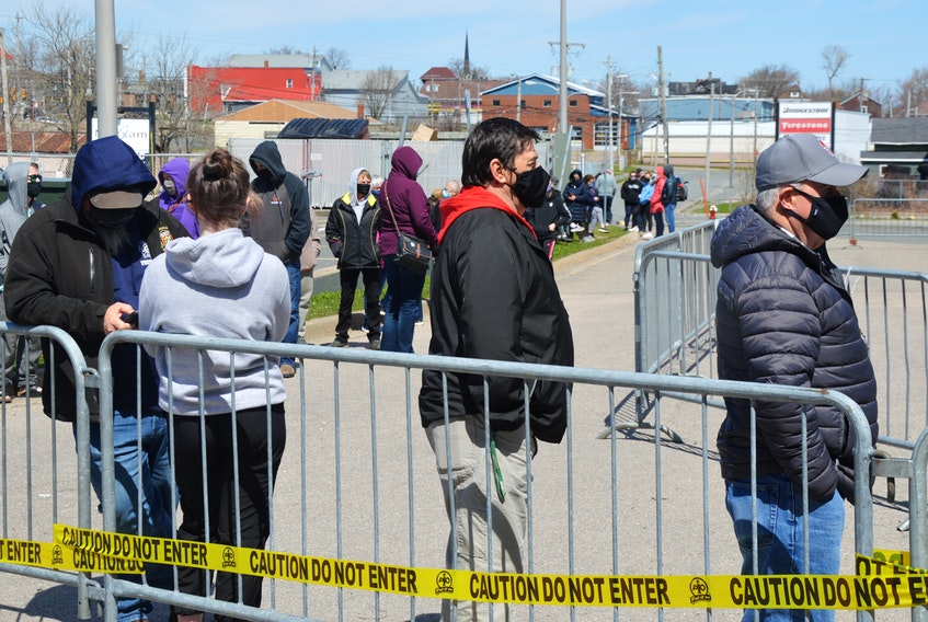 At least 100 people arrive early at Centre 200 to line up for COVID-19 rapid testing — including those who heard about a possible COVID exposure at Riverview High School. IAN NATHANSON/CAPE BRETON POST