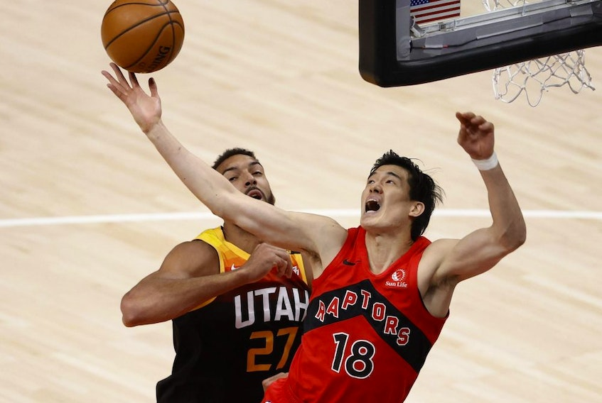 Toronto Raptors forward Yuta Watanabe (18) and Utah Jazz centre Rudy Gobert (27) battle for the rebound in the first quarter at Vivint Arena in Salt Lake City on May 1, 2021.